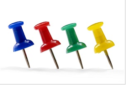 A row of pushpins from the site www.marketingprofs.com  standing up at an angle