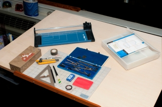Drafting table with graphic design tools